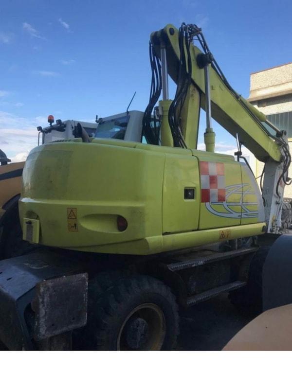 Excavatoare pe Roti  New Holland MH-CITY